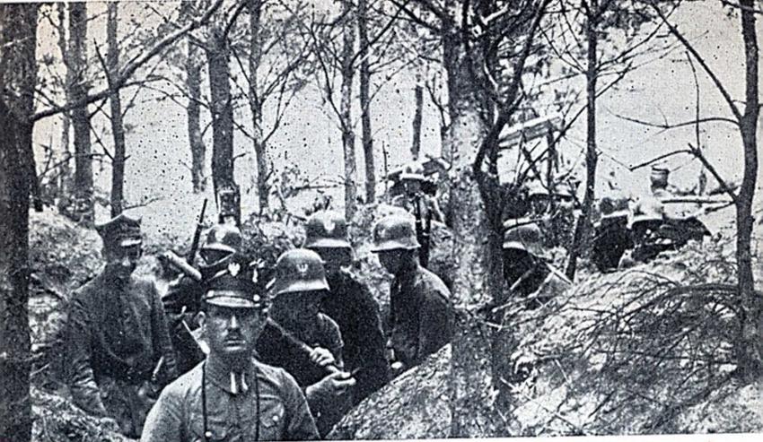 Powstańcy wielkopolscy w okopach w 1919 roku zimą na fotogorafii, a także informacje o wybuchu powstania wielkopolskiego krok po kroku